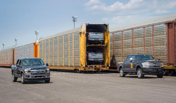 Loading pickup trucks onto an autorack railcar